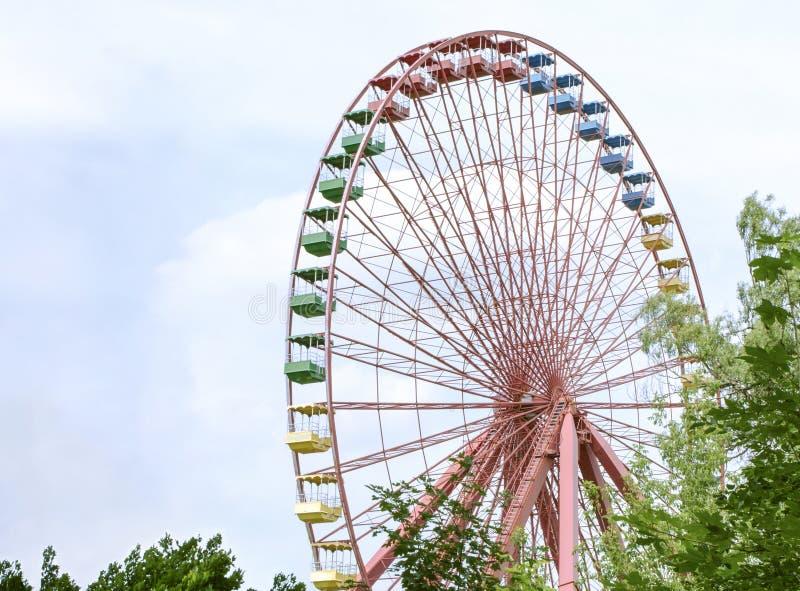 Old colorful ferris wheel. In abandoned amusement park. Spreepark Berlin stock photos