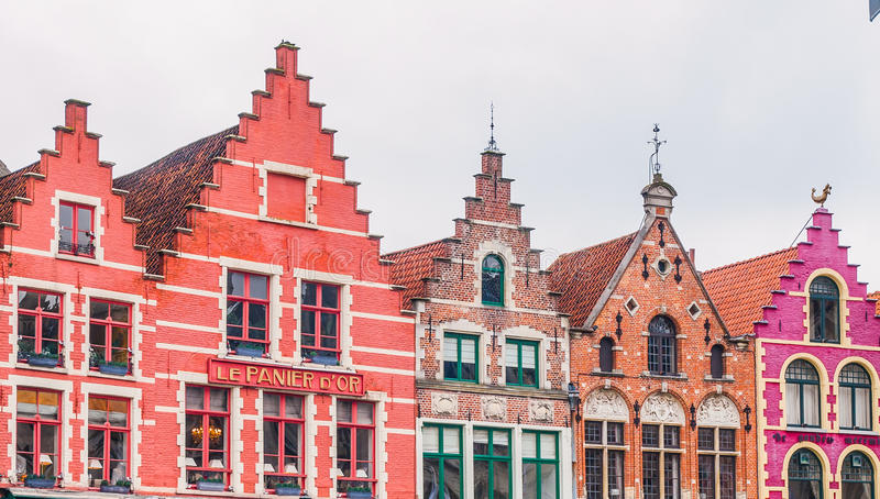 Old colorful gables of brick houses on Market Square in Bruges, Belgium stock photos