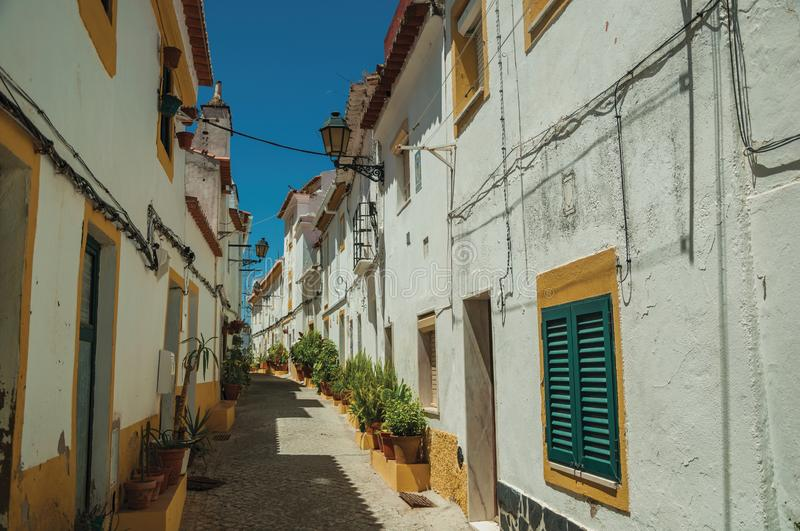 Old colorful houses in a deserted alley at Elvas stock photo