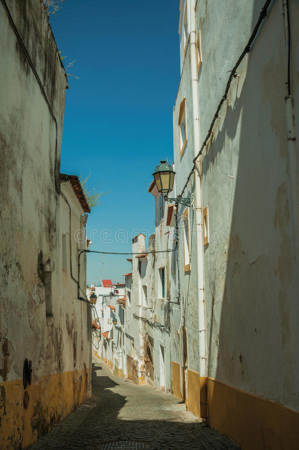Old colorful houses with peeling plaster wall in a deserted alley stock photo
