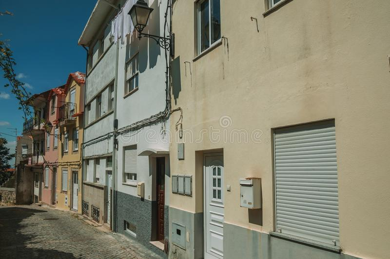 Colorful houses with public lamp on deserted alley royalty free stock photo