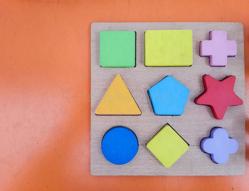 Old colorful wood toy, shape of colored wooden royalty free stock photos