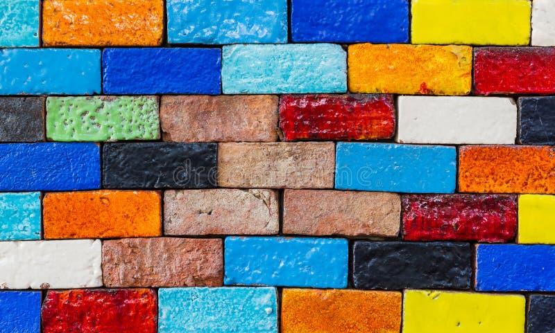 Old colourful brick, wall texture background. Old colourful brick, wall texture background, stained tiled brickwork horizontal pattern royalty free stock photo