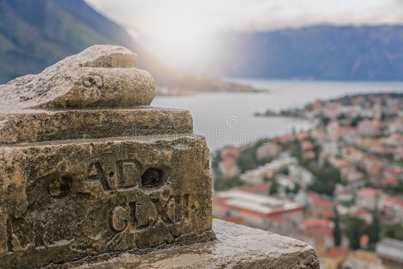 Old column base detail above Kotor town and bay stock photography