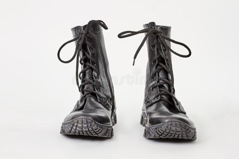 Old combat boots over white. stock photography
