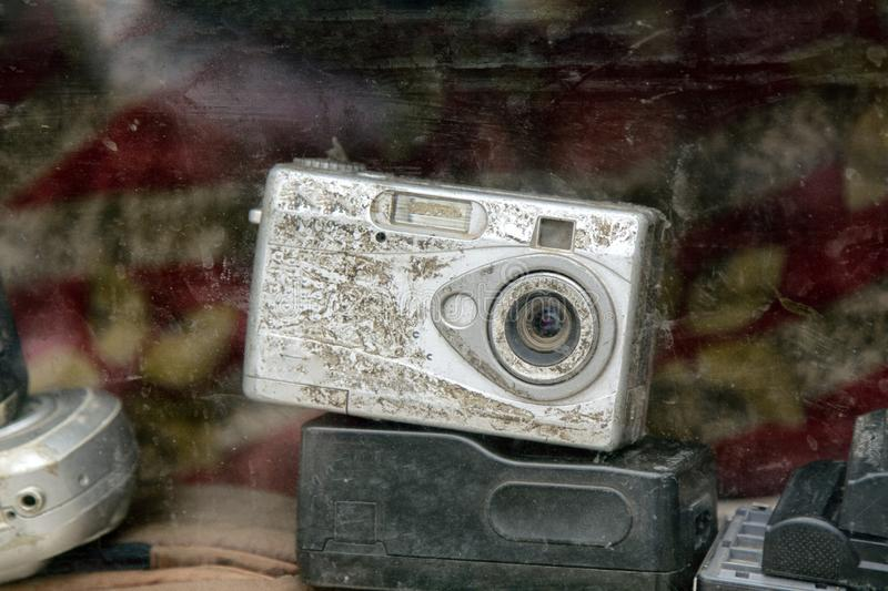 Old compact camera. Old photo equipment is dusty and not in demand. old compact camera stock photo