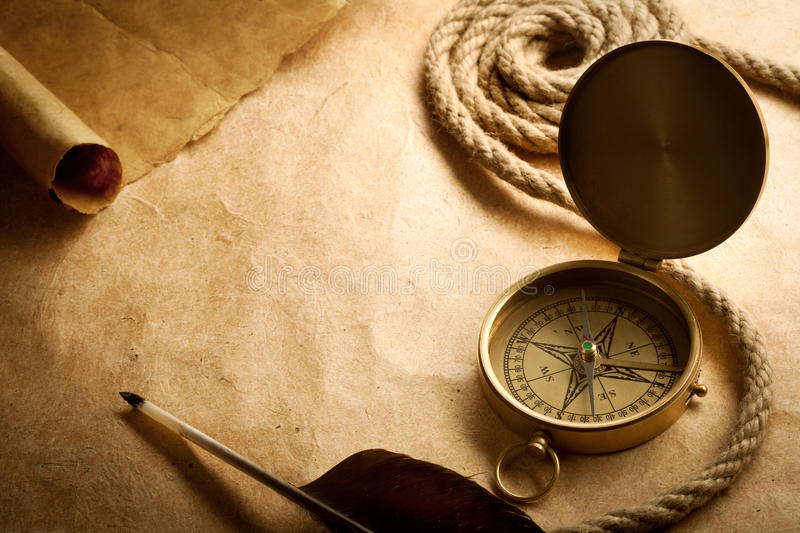Old compass on antique paper stock photo