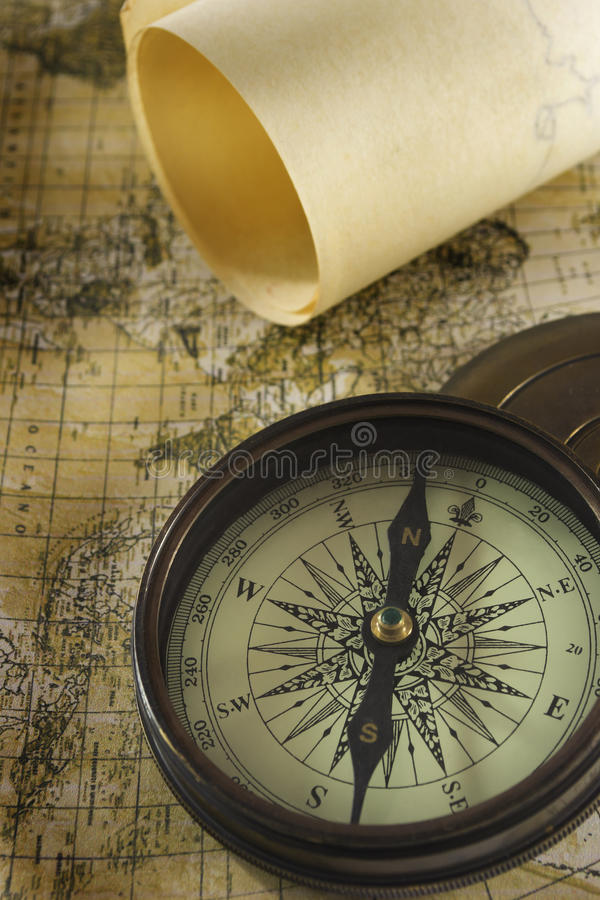 Old compass over map. Old brass compass over antique map royalty free stock photos