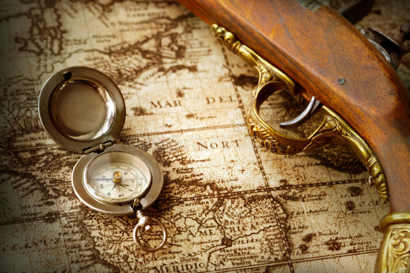 Old compass on vintage map. Photo of a old compass on vintage map stock photos