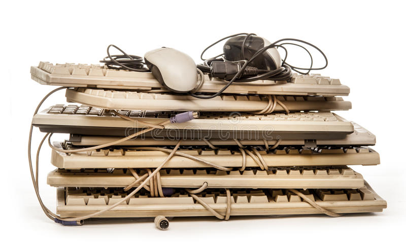 Old computer hardware and keyboards. On white stock image
