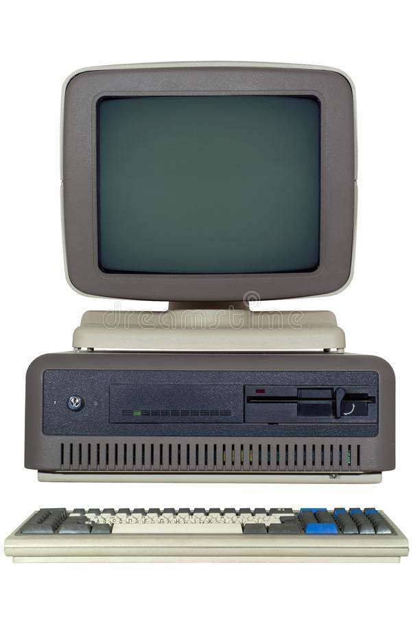 old computer late 80`s with a horizontal system unit, and a CRT monitor isolated royalty free stock photo