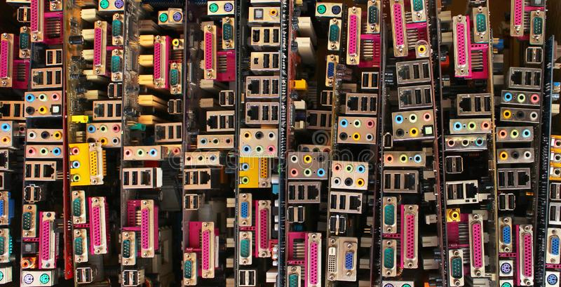 Old computer motherboards. Piles of obsolete hardware and electronic components royalty free stock images