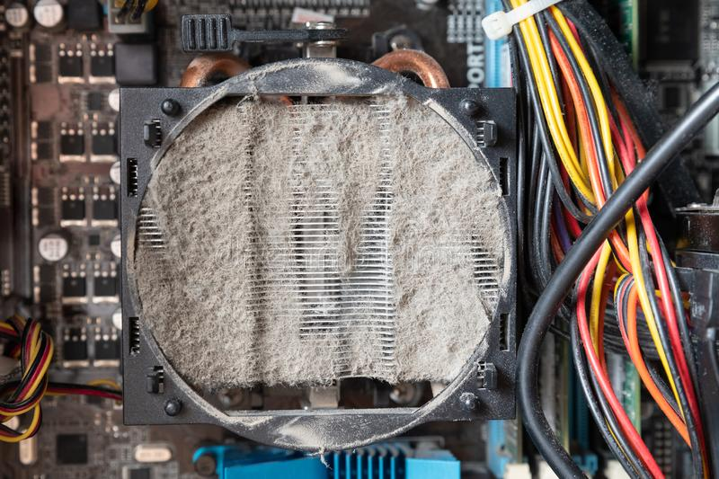Old computer system unit cooler with dust inside. Dust on the computer pc processor cooler with computer case fragment stock photos