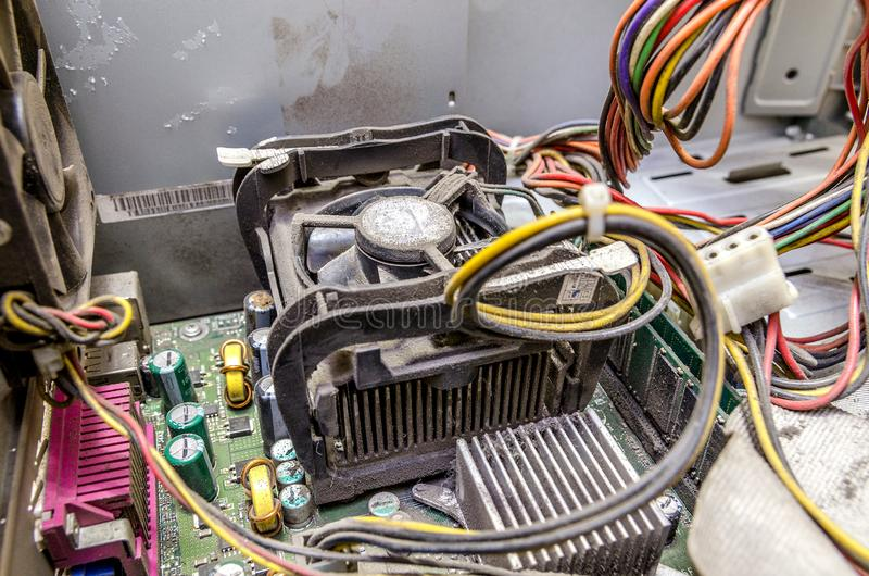 The dust inside computer. Old computer system unit with spiderweb and dust inside royalty free stock photos