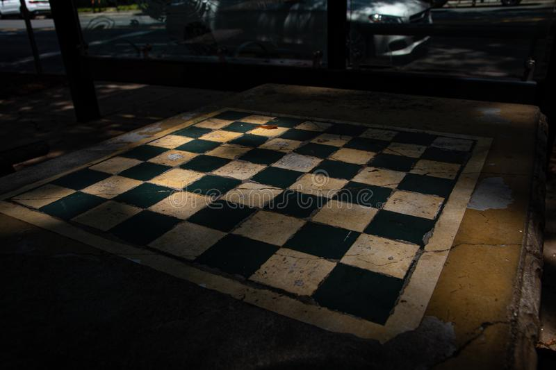 Old Concrete Chessboard. An old concrete chessboard table on the sidewalk. Checkerboard. Shaded recreation area. Charlotte, North Carolina stock images