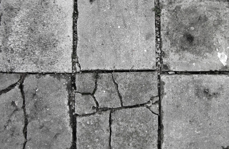Old concrete floor with cracks background stock photo