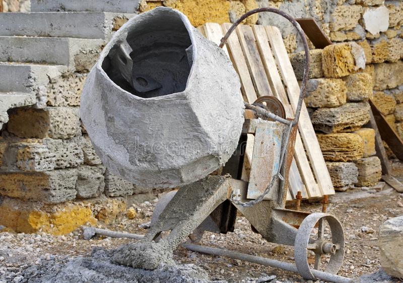 Old Concrete Mixer. On the construction site stock photos
