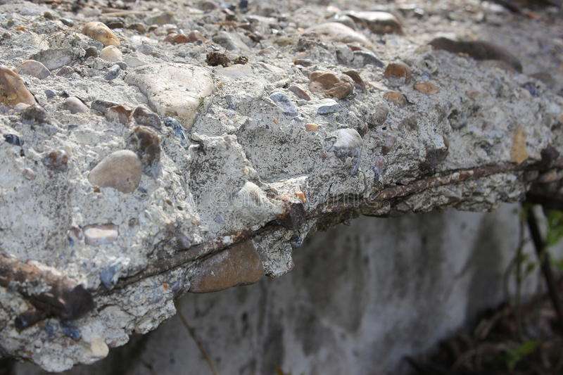Old concrete slab. Broken concrete with the remnants of rebar royalty free stock images