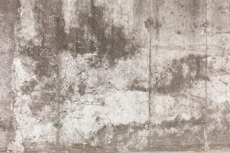 Old concrete wall with divorces, chips, cracks and holes.  royalty free stock image