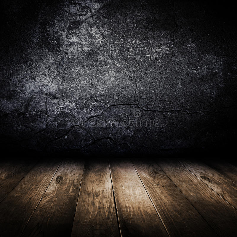 Old concrete wall and wooden floor. royalty free stock photography