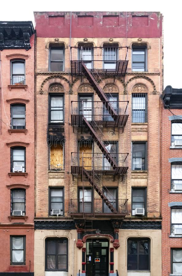 Old condemned building with boarded windows in the Lower East Side neighborhood of Manhattan in New York City. NYC stock image