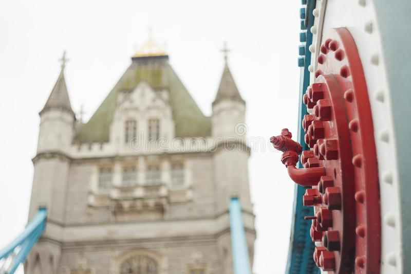 Old construction elements from metal. Tower bridge in background defocused stock photo