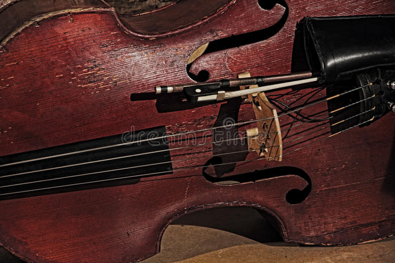 Old contrabass taken closeup. Retro style toned image royalty free stock image