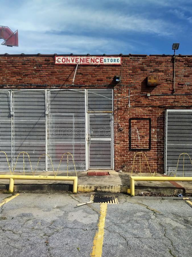 Old Red Brick Storefront Exterior Wall and Vintage Arrow Shaped Sign. stock image
