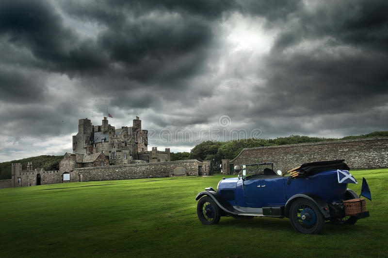 Old Convertible in front of a castle. An old convertible car in front of a Scottish caslte royalty free stock photos