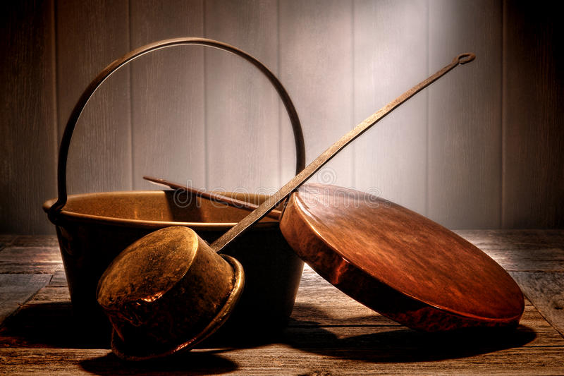 Old Copper Pots and Pans in Aged Antique Kitchen royalty free stock photos