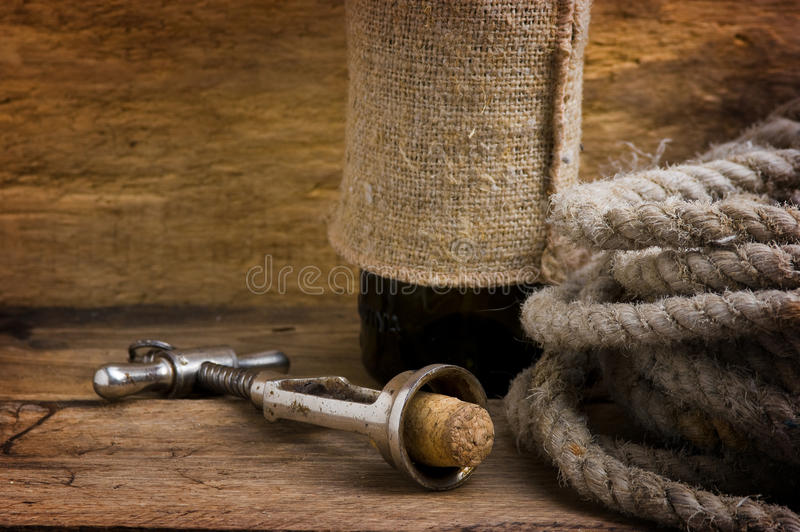 Old corkscrew with a cork and a bottle stock image