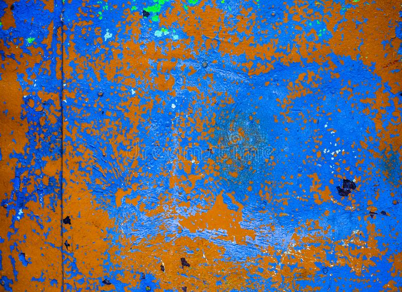 Old corroded metal wall background with flaky blue green and brown paint .Rusty flaky cracked metal surface.Abstract the surface t royalty free stock photo