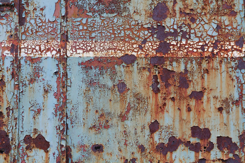 Old corroded steel surface. With cracked paint royalty free stock photography