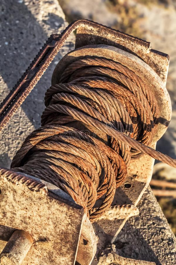 Old Corroded Winch With Rusty Steel Cable Tangled Coil Detail.  royalty free stock photos