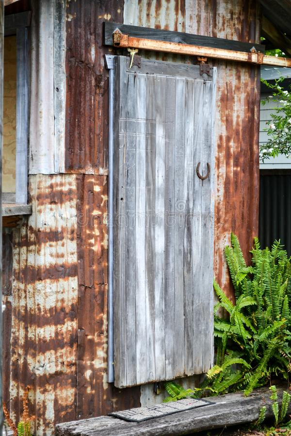 Download Old Corrugated Iron Tin Shed With Aged Wooden Door Stock Photo - Image of retro & Old Corrugated Iron Tin Shed With Aged Wooden Door Stock Photo ...