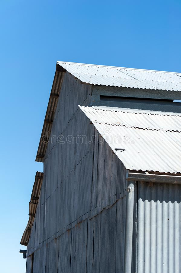 Old corrugated iron wool shed on outback station in Australia stock image