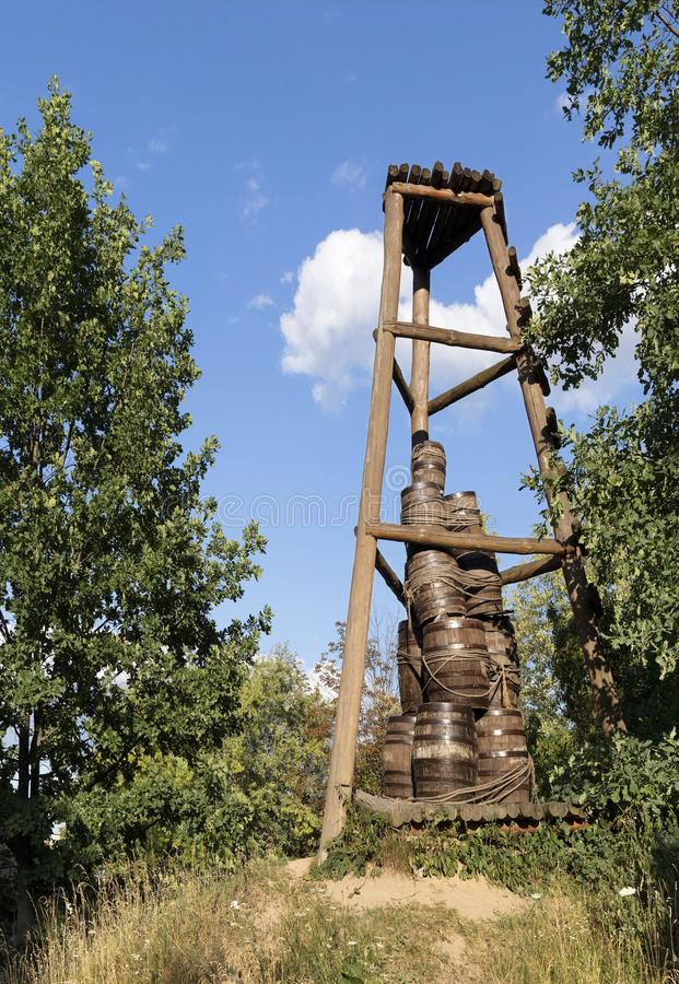 Old Cossack wooden watchtower on a hill among the forest royalty free stock photo