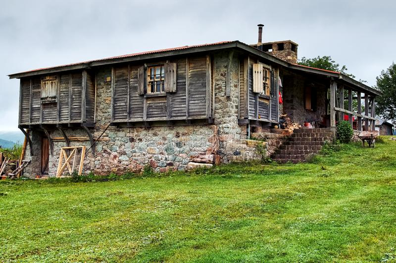 Old cottage in Ordu Turkey. Old stone and wooden cottage surrounded by green field in the highland of Ordu, Turkey royalty free stock photography