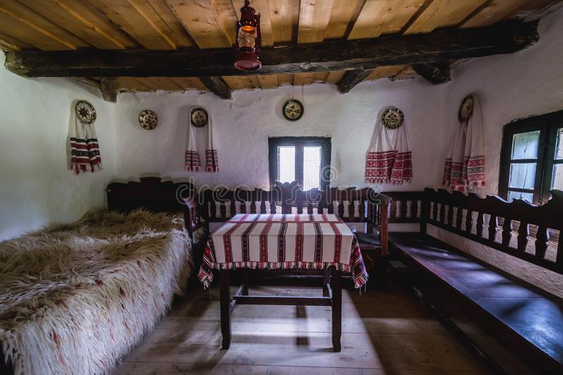 Old cottage in Romania. Inside one of the traditional houses of Oas County heritage park in Negresti-Oas, Romania, old, cottage, hut, bed, bedroom, wood, wooden royalty free stock image