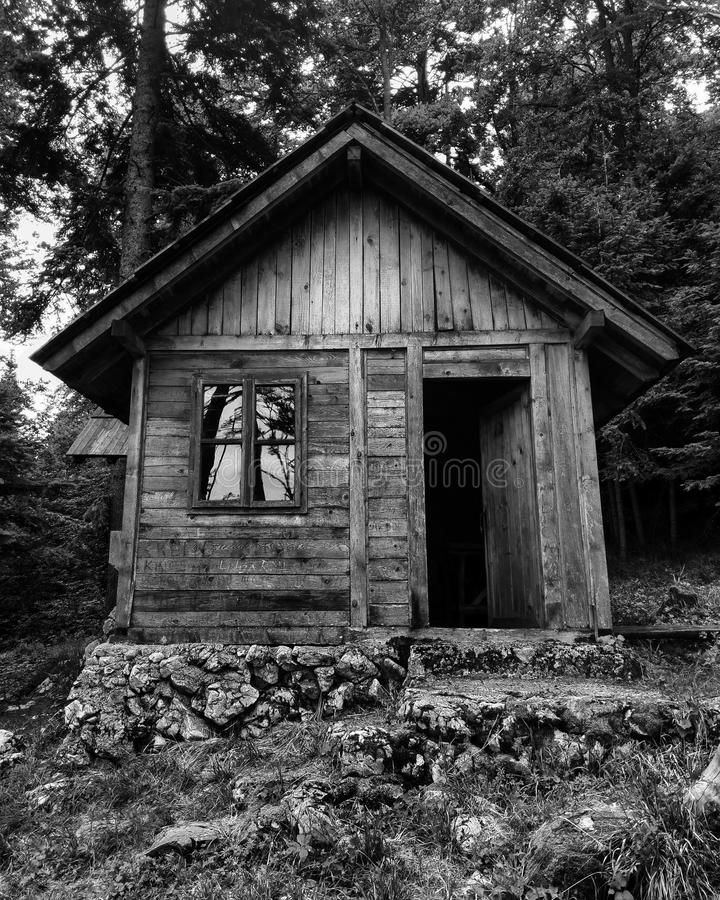 Old cottage in the woods stock photos