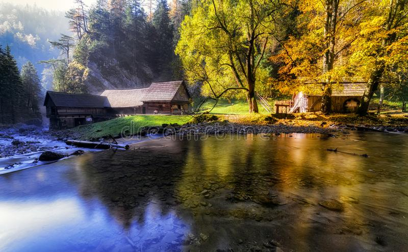 Old cottages under colorful trees and river royalty free stock images