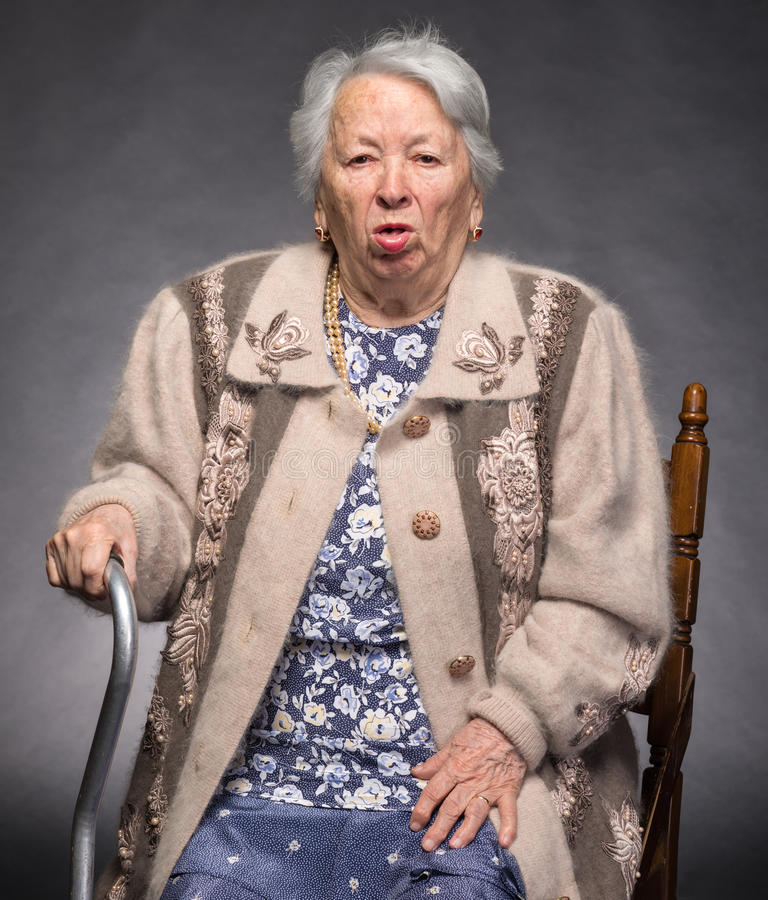 Old coughing woman. Portrait of old coughing woman stock photo