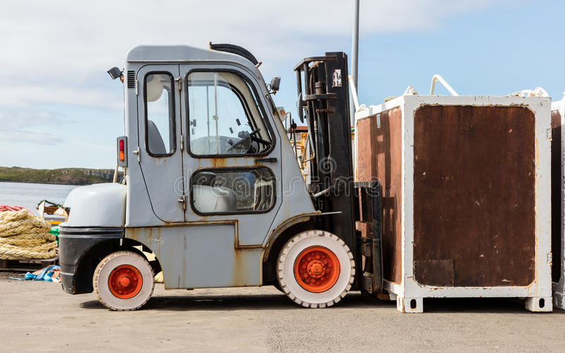 Old counterbalance forklift. Small harbour in Iceland royalty free stock photos