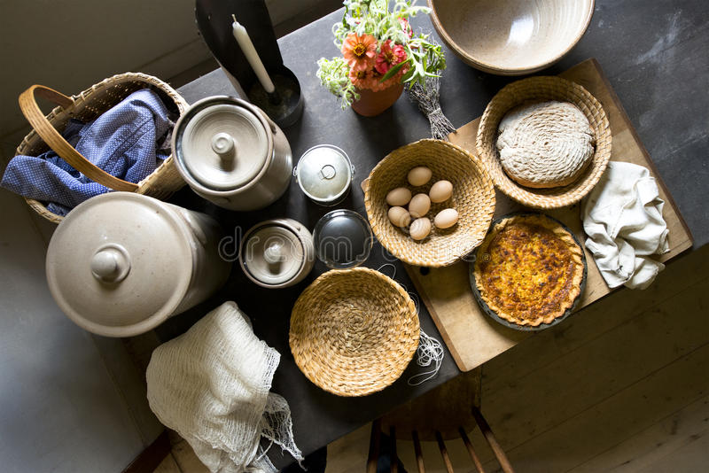 Old Country Farm Kitchen Home Food Cooking. Old fashioned country farm cooking in a kitchen. Were seeing a table top full of homemade organic food, just like royalty free stock photo