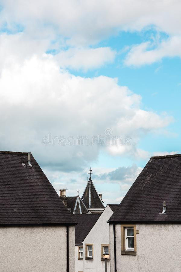 Old country homes in the village of stirling, scotland under a bright blue teal sky royalty free stock image