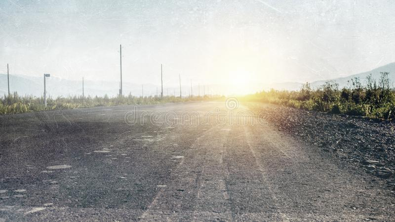 Old country straight abandoned road royalty free stock image