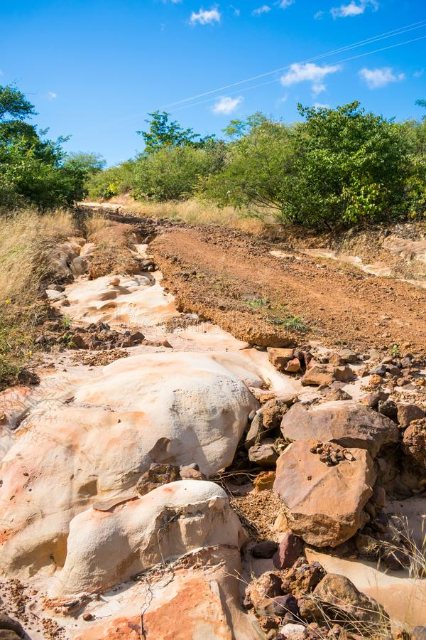 Old countryside road with eroded soil and rocks in the countryside of Oeiras, Piaui. Northeast Brazil stock image