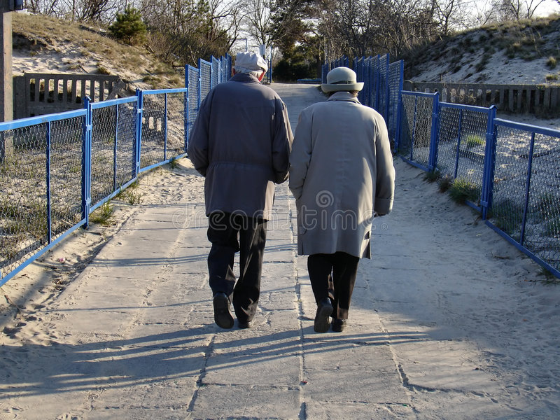 Old couple after beach walk stock photos