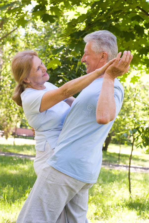 Old couple dance stock image