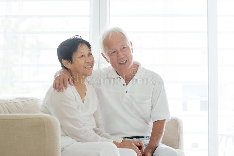 Old couple at home, looking away stock image